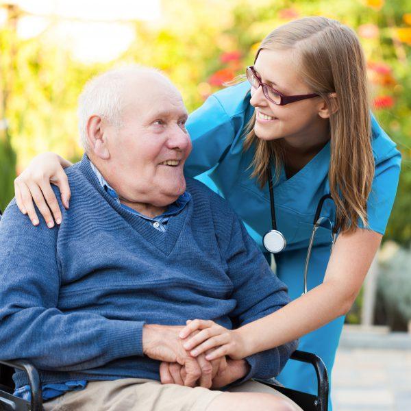 An elderly man and nurse